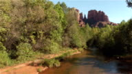 Beautiful river running under Red Rock Cathedral mountain in Sedona video