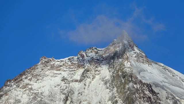 Beautiful rocky peaks of Kamen Volcano on sunny day and blue sky video