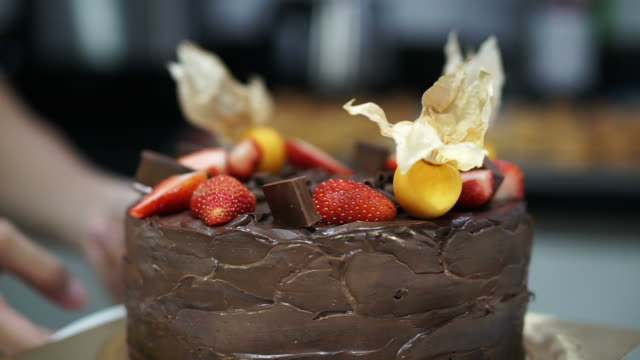 Beautiful rustic dark chocolate pound cake with strawberry and cape goose berry on top video