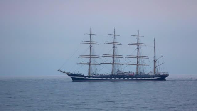 beautiful sailing ship in the evening sea video