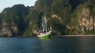 Beautiful sailing yacht near the tropical island video