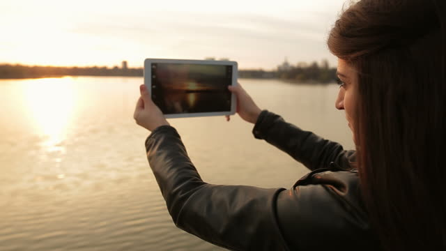 Beautiful scene with a young adult using digital tablet. video