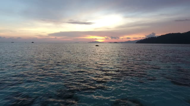 Beautiful Sea, Flying on clean sea surface at sunset or sunrise. video