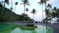 Beautiful Silhouette luxury umbrella and chair beach with pool video