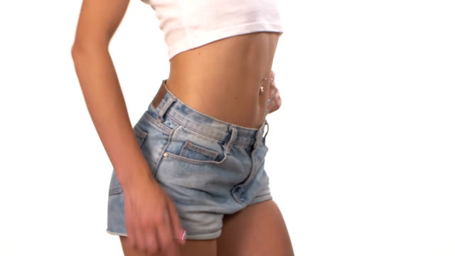 Beautiful, slender female body, waist, on white video