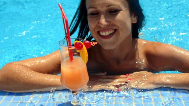 beautiful smiley woman swimming in the pool video