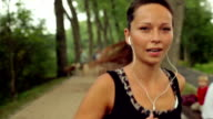 Beautiful, smiling woman running in the park. video