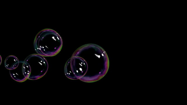Beautiful Soap Bubbles flying on black background. HD 1080. video