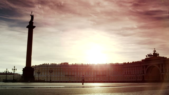 Beautiful summer sunrise over empty Palace Square in Saint-Petersburg. Lonely tourist passes throuth square video