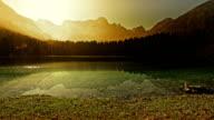 Beautiful sunrise at the mountain lake video