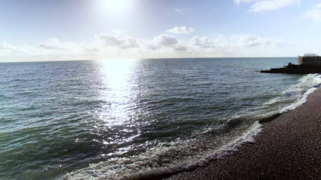 Beautiful Sunrise with Beach and Stone Pier video