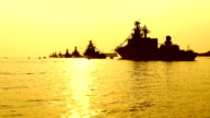 beautiful sunset and silhouettes of warships video