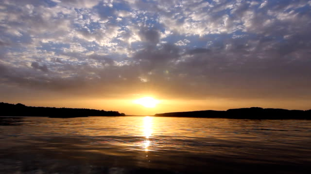 Beautiful sunset at the river amazing colors video