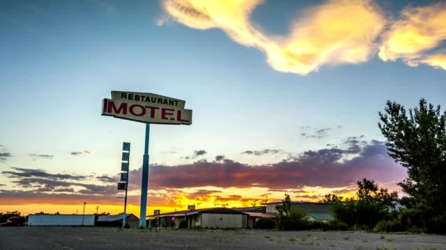 Beautiful sunset behind Restaurant Motel sign video