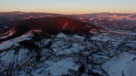 Beautiful sunset over mountain village in winter, aerial view 5 video