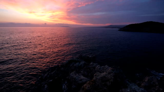 Beautiful sunset over see in slow motion video