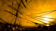 beautiful sunset through the rigging of a sailing ship video
