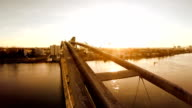 beautiful sunset view. aerial view of modern bridge. slow motion video