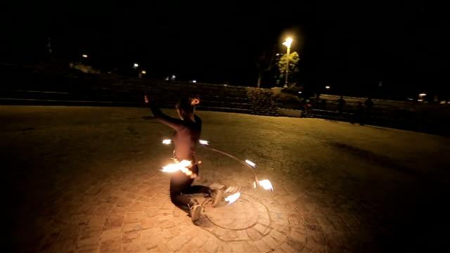 beautiful teenage girl spinning fire hoop video
