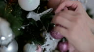 Beautiful teenager girl decorating the Christmas tree video