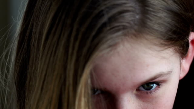 Beautiful teenager looking at camera video