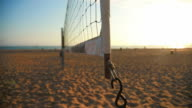 Beautiful tilt up of Volleyball net at the beach during sunset video
