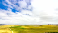 Beautiful Timelapse with amazing clouds moving over vast farm fields on a windy summer day video