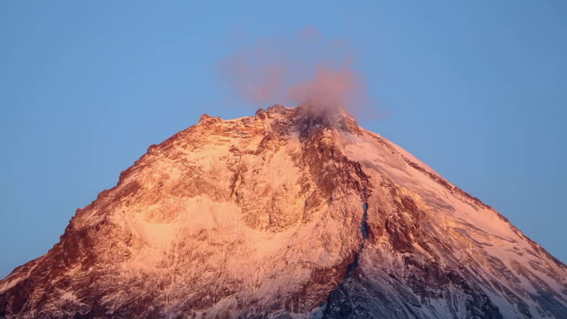 Beautiful top of Kamen Volcano with beautiful rocky peaks at sunrise video