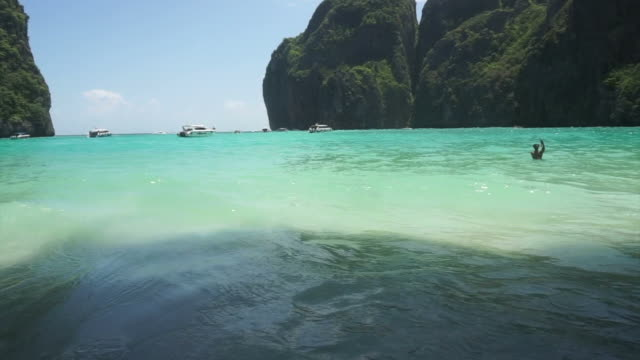 Beautiful tropical beach and cave limestone mountain in Phi Phi island of Thailand video