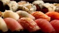 Beautiful variety of fresh sushi on a plate video