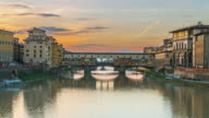 Beautiful view at buildings and colors are reflected, The River Arno in Florence, Italy. video