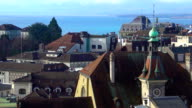Beautiful view of blue Lake Geneva, red roofs and Gothic spires in Lausanne video