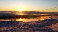Beautiful view of moving cable car in snow-covered mountaines at sunset time. Sweden video