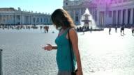 beautiful walking young woman using her phone video