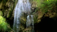 Beautiful waterfall in forest, reverse motion video