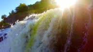 Beautiful waterfall landscape, sunshine, wild nature, slow-mo video