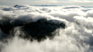 Beautiful waves of low clouds flows in winter mountains time lapse video
