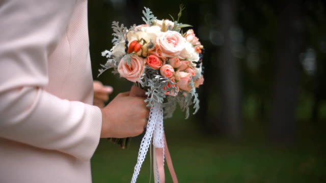 Beautiful wedding bouquet in the hands of the bride video