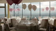 Beautiful wedding hall decorated with balloons, ribbons and flowers video