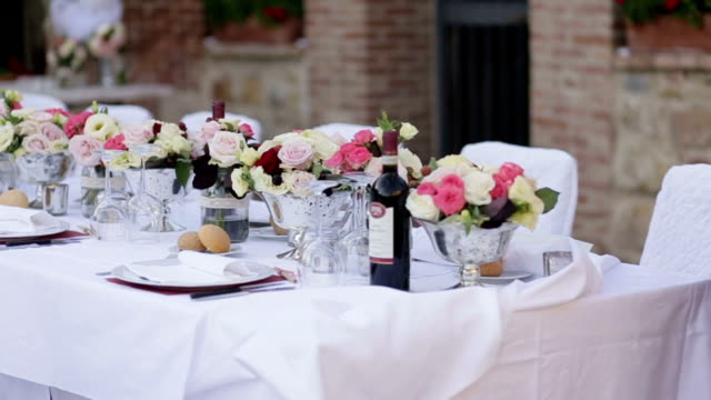 Beautiful wedding table setting. Waiters served wedding table. Festive table in the restaurant. video