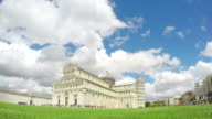 Beautiful white clouds flying above Pisa cathedral and leaning tower in Italy video