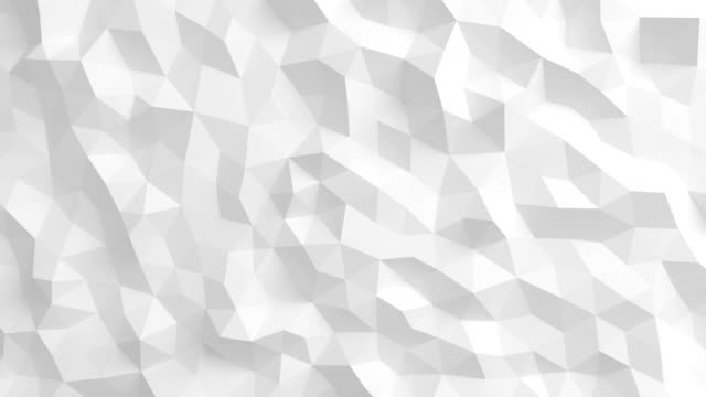 Beautiful White Polygonal Surface Waving in Seamless 3d animation. Abstract Motion Design Background in 4k. Computer Generated Process. Ultra HD. video
