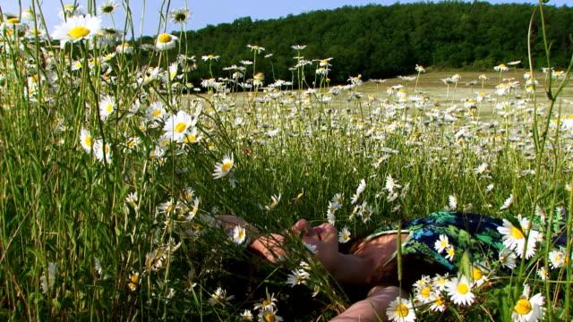Beautiful woman among daisies video