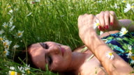 Beautiful woman among flowers video