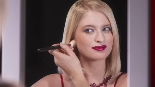 HD: Beautiful Woman Applying Evening Makeup video