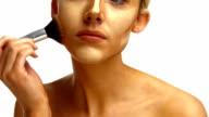 Beautiful woman applying make up video