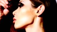 Beautiful woman applyling mascara v1 video