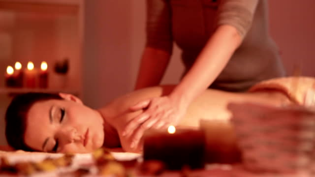 Beautiful woman at massage therapy video