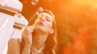 Beautiful woman blows bubbles 4 video