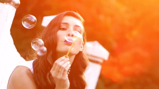 Beautiful woman blows bubbles 5 video